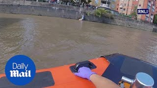 RNLI save woman and her dog after getting stuck on a ladder