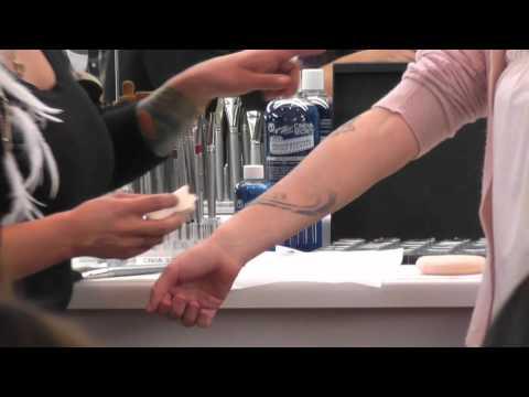 Covering tattoos with makeup: Cinema Secrets Makeup class