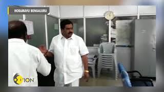 Watch: Congress leader splashes petrol inside BBMP office; threatens to set ablaze