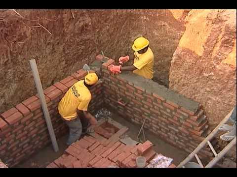 BUILDING WITH BRICKS OR BLOCKS