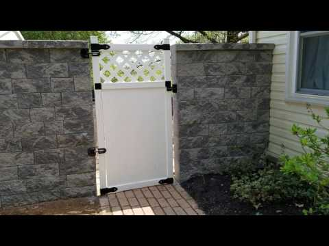 Backyard privacy retaining wall & gate installation in Hanover, PA - Ryan's Landscaping