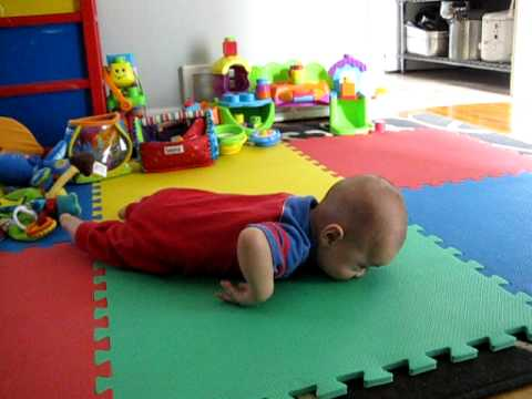 Adorable baby learning to crawl