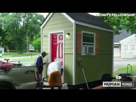 Homeless man jumps for joy over new tiny house