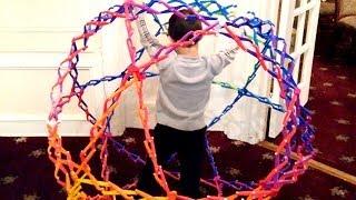 Boy in Hoberman Sphere Mega Ball ~ Incredible Science