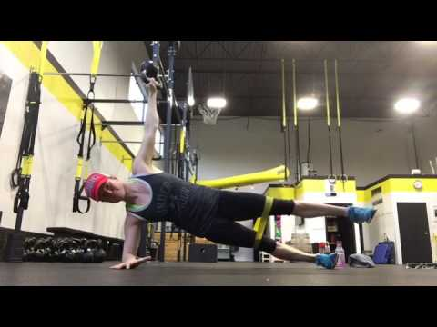 Single Leg Side Plank With Bottoms Up Kettlbell Hold And Banded Leg Abductions