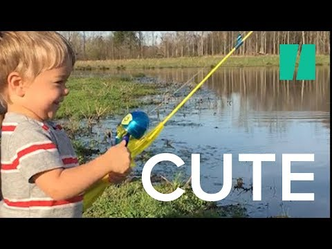 Little Boy Catches Fish with Toy Rod