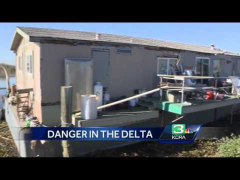 Boaters concerned over abandoned house barge in Delta