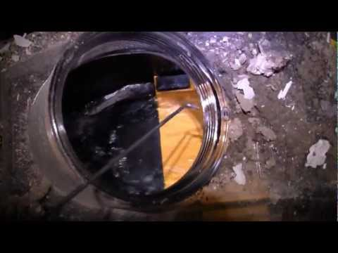 Cleaning a sewer back flow valve. HOW TO AND WHY