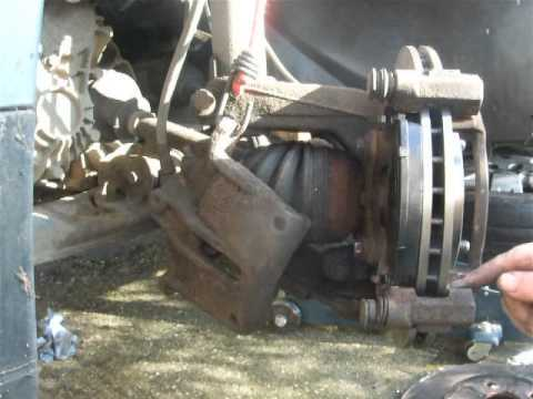 REPLACING FORD MONDEO MK3 FRONT BRAKE DISCS AND PADS PART 1 AND 2