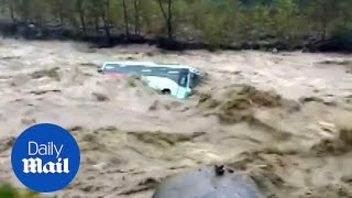 Shocking moment monsoon floods cause bus to be swept away