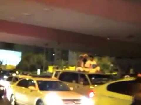 Guy Playing the Tabla on Top of a Car in Doha!