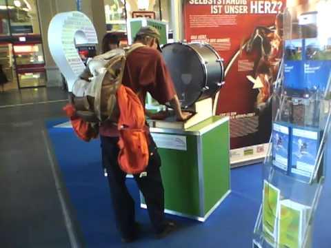 Homeless person (?) checking his pulse at Frankfurt Hbf