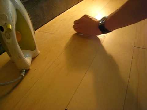 Removing dents out of non colored Parky floors with a hot iron