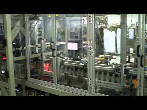PCM HIGH SPEED ROBOTIC COIN FEEDING SYSTEM INTO OVAL CAROUSEL WITH INK-JET PRINTING