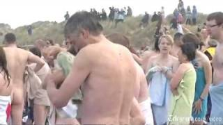 Nude swimmers bear all to attempt world skinny dipping record