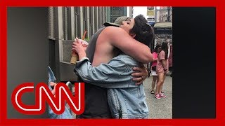 Father goes viral for giving out hugs at Pride parade