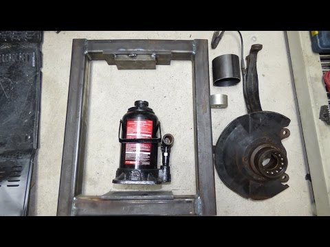 homemade shop press removing front wheel bearings