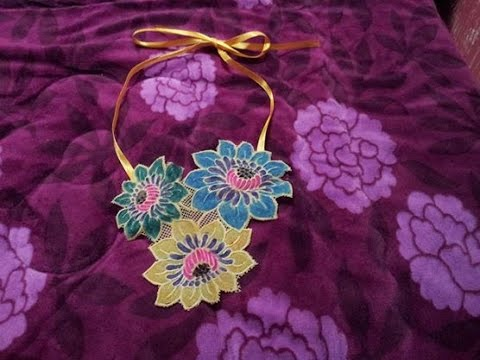 DIY bib necklace made from vinyl doily placemat