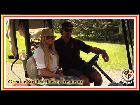 Sheldon Souray with Kelly Kelly on Greater Strides Hockey Academy
