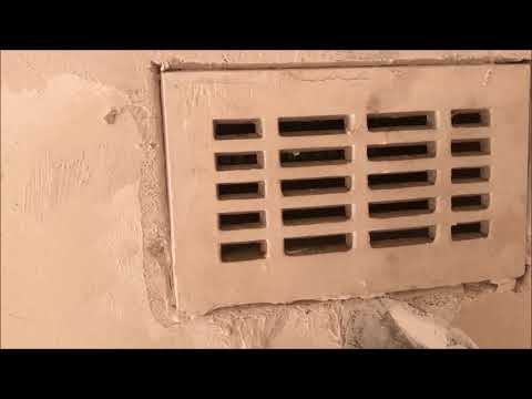 Installing  a vent onto a solid brick plaster wall
