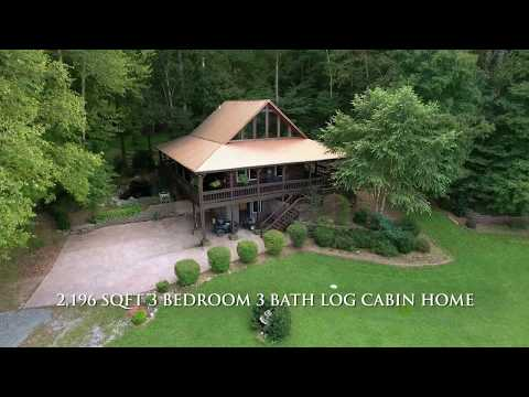 Custom log home and 57 acres for sale in Trigg County, KY.