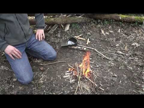 Bushcraft - How to make fire with a knife and a shoe lace (Part 3) Bow & drill - ESEE Laser Strike