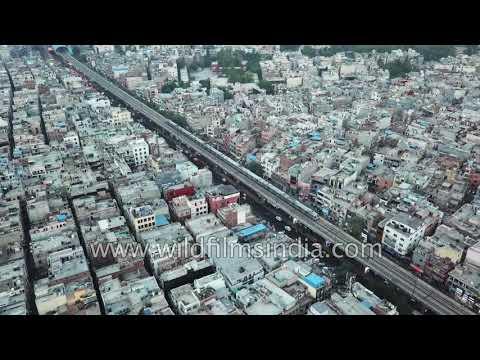 Metro line cuts across congested Delhi: Nirman Vihar & Preet Vihar metro stations in a single frame