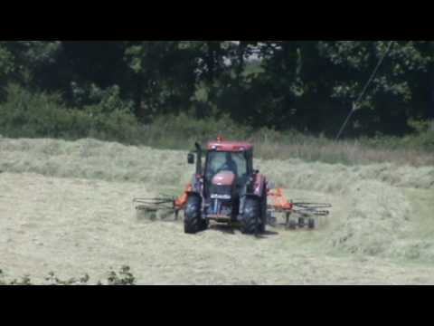 Raking Grass for Hay with Case Tractor.