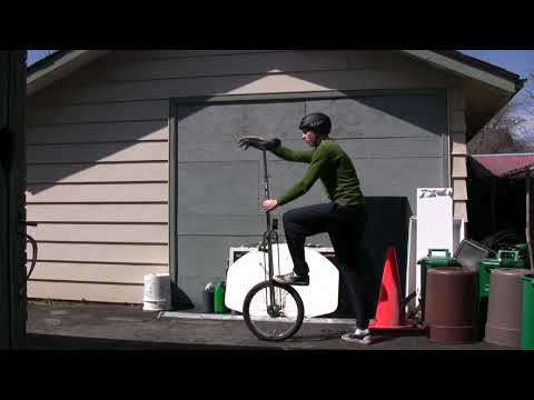 Mounting a Giraffe Unicycle