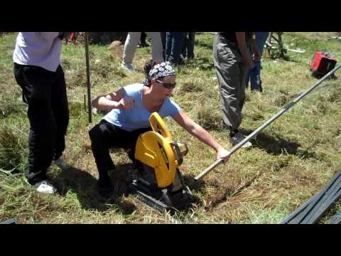 Jennifer using saw to cut iron bars for fence at Orphanage in Ethiopia. Oct 2009