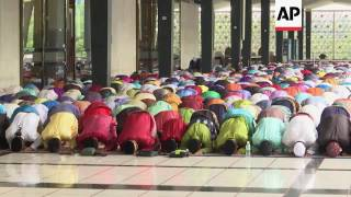 Muslims in Malaysia mark Eid with prayers