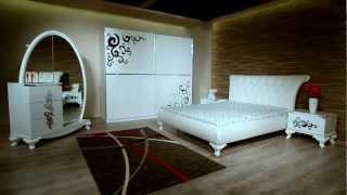 """MNS Mobilya Yatak Odası Takımları  Sedef Yatak Odası  -""""Sedef Yatak Odası Takımı"""" için en kaliteli malzemeler, özel tasarlanmış metal kulplar, parlak taşlar ve lükens ayaklar kullanılmıştır. -Karyola ve karyola başlığı , beyaz deri ile kaplıdır.  -Dolap kapıları sürgülüdür ve kapıların yavaşça kapanmasını sağlayan fren sistemine sahiptir. -Dolap kapaklarındaki desenler ürüne özel tasarlanmıştır. -Fonksiyonel dolabı , tüm giysilerinizi saklayabileceğiniz kadar geniştir , sağ ve sol yanında özel LED ışık sistemi vardır . -Şifonyer boy aynası fonksiyonel olup sağ tarafa sürgü sistemiyle açılabilir özel bölmeli olarak tasarlanmıştır. -Şifonyerin sağ arka bölümünde askılık bulunmaktadır . -Sedef"""
