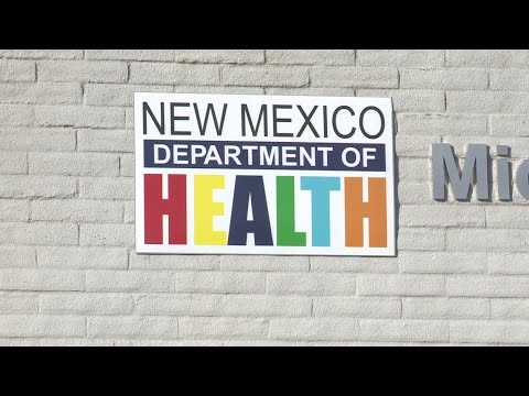 What's causing the birth certificate hold up in Albuquerque?