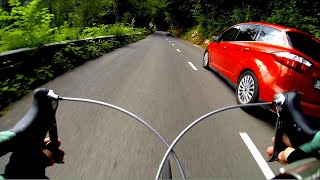 Extreme Road bike downhill. Overtaking cars.