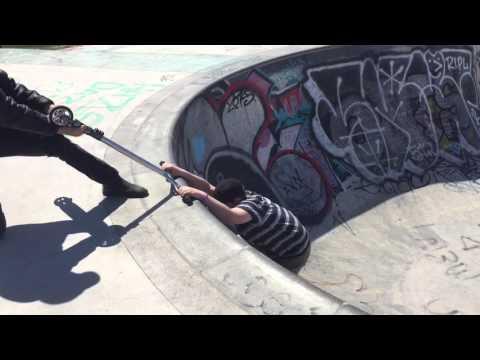 Scooter kid gets stuck in huge skatepark bowl! LOL