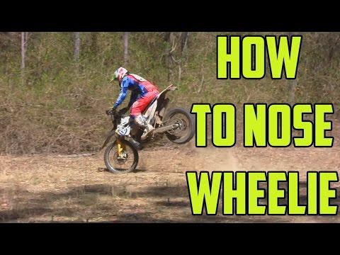 How to nose wheelie a dirt bike