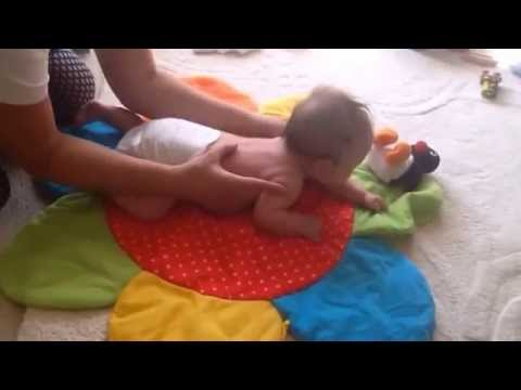 Helping baby to roll and get into tummy time
