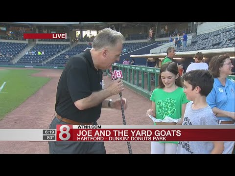 Storm Team 8 Co-Chief Meteorologist Joe Furey prepares to throw out first pitch at Yard Goats game