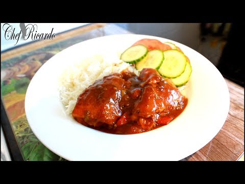 BEST JAMAICA Brown stew chicken with rice and salad