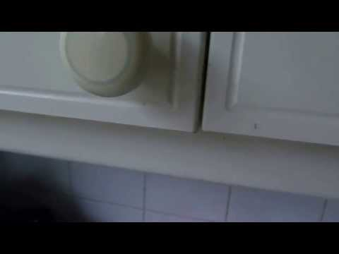 How to re-align kitchen cupboard doors that have dropped out of line.