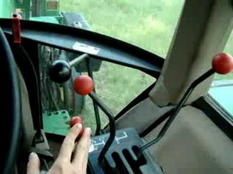 john deere 2355 cutting hay