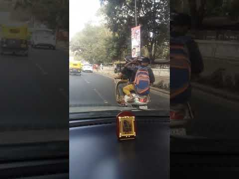 Bangalore guys without license riding triple seat.. breaking all traffic rules