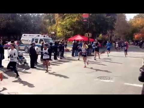 NYC Marathon 2014 - Runners Go By Mccaren Park in Williamsburg, Brooklyn