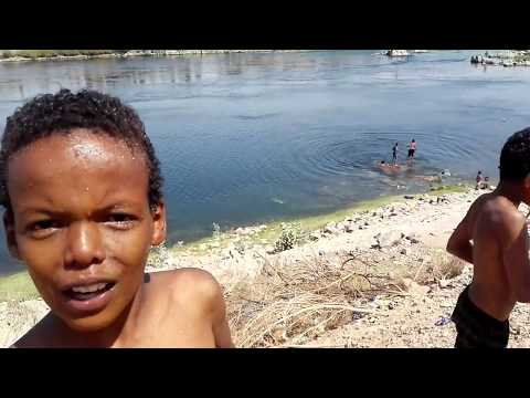 Children swimming and playing at Garb Seheil Nubian village near the Aswan Dam