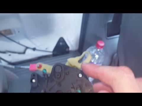 How to remove the sliding door lock actuator on a Dodge Caravan and Chrysler Town and Country