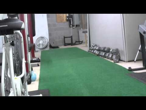 Putting Turf Down in Fitness Studio.AVI