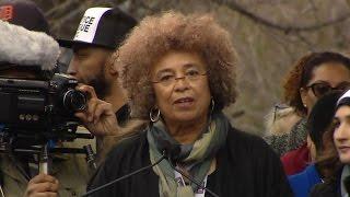 Watch legendary activist Angela Davis rally Women
