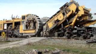 Awesome railroad machine/Loram shoulder ballast cleaner