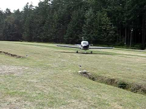 Carrie landing RV-12 on Center Island, Washington