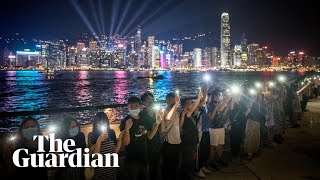 Hong Kong protesters form 30-mile human chain across city